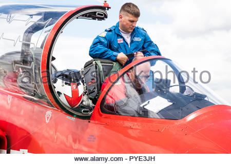 Red Arrows pilots in cockpit on RAF Scrampton, UK - Stock Photo