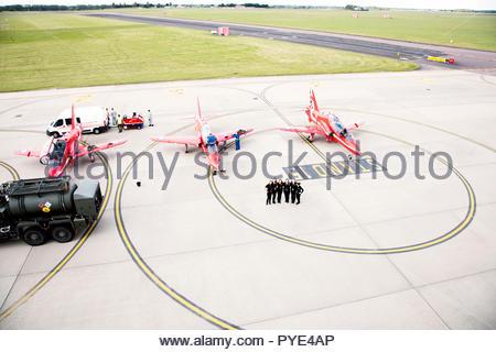 Women by Red Arrows airplanes on RAF Scrampton, UK - Stock Photo