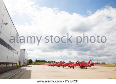 Row of Red Arrows airplanes on RAF Scrampton, UK - Stock Photo