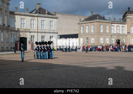 Palace Watch by the Royal Life Guards in Amalienborg Square. A Palace Watch is when no member of the royal family is in the palace. - Stock Photo
