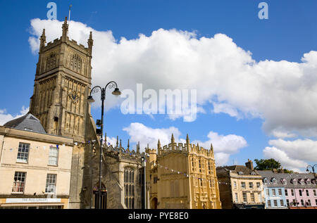 Wide view of the Church of St John the Baptist and neighbouring buildings, Market Place, Cirencester, Gloucestershire, England - Stock Photo