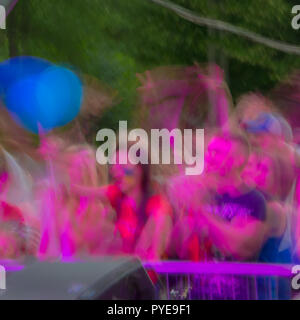 blurred background, emotional viewers. Rock concert at night on a city street. - Stock Photo