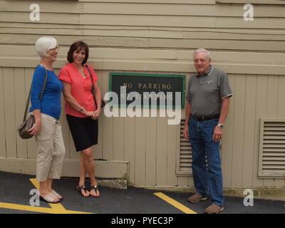 Three friends outside NJ antique store in Lafayette, NJ. - Stock Photo