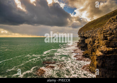 View towards Anvil Point Lighthouse from Tilly Whim Caves on the South West cost path, Durlston Country Park, Swanage, UK - Stock Photo