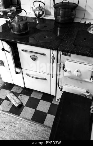 Vintage wood or coal fired cooking stove in an old Swedish farm house in northern Sweden - Stock Photo