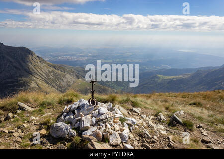 Autumn hiking in Aosta valley, Gressoney, Italy. View of the city of Biella from Point Sella near the Coda mountain refuge. - Stock Photo