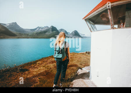 Woman tourist walking at Norway seaside  enjoying view outdoor travel vacations lifestyle girl with backpack sightseeing - Stock Photo
