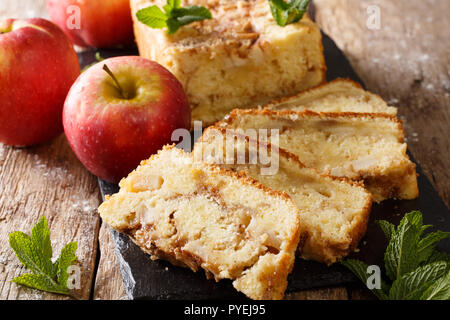 Delicious homemade apple bread with cinnamon and mint close-up on the table. horizontal - Stock Photo
