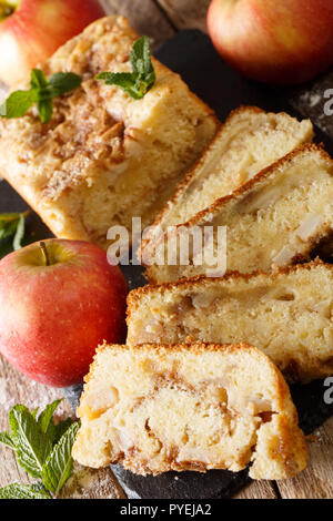 Freshly baked apple bread with cinnamon and mint close-up on the table. vertical - Stock Photo
