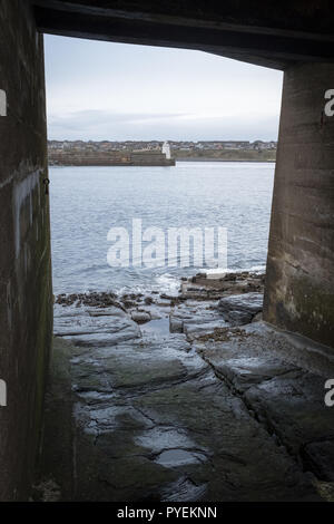 View of Wick harbour in Caithness, taken from underneath the old, abandoned lifeboat station. - Stock Photo