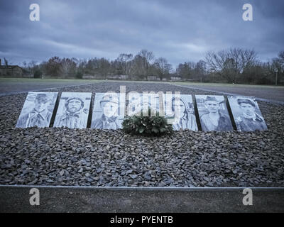 Orianenburg, Germany - December 12, 2017: Shot of a row of pictures dedicated to victims at the Sachsenhausen Concentration camp - Stock Photo