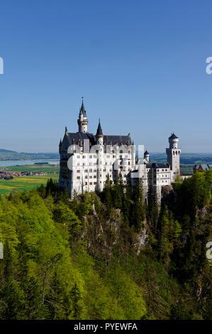 Schloss Neuschwanstein (Neuschwanstein castle) seen from Marienbrücke, near Hohenschwangau, Allgäu, Bavaria; Germany - Stock Photo