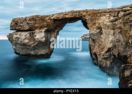 Seascapes of Dwejra Gozo Azur window, blue hole and inland sea Malta during winter with long exposure - Stock Photo
