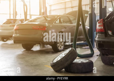 Car service center. Vehicle raised on lift at maintenance station. Auomobile repair and check up - Stock Photo