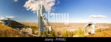 Ski Jumping Tower and Wide Panoramic Landscape of Rocky Mountain Foothills in Canada Olympic Park (COP) near City of Calgary, Alberta - Stock Photo