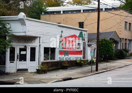 A classic sign for Coca Cola on the side of an old corner store in the historic Oakwood neighborhood of Raleigh North Carolina. - Stock Photo