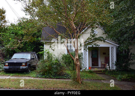 A rundown home with old truck out front in Raleigh North Carolina's historic Oakwood neighborhood. - Stock Photo