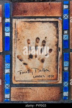 Cannes, France - October 18, 2013: Hand print of Timothy Dalton on the Cannes Walk Of Fame - Stock Photo