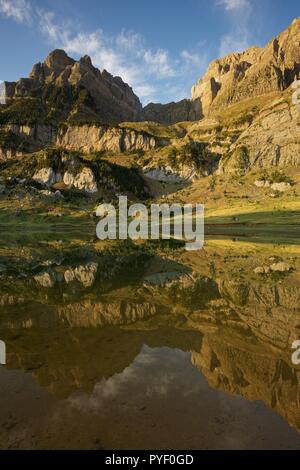 Morning Light and still waters at Ibon de Piedrafita - Stock Photo