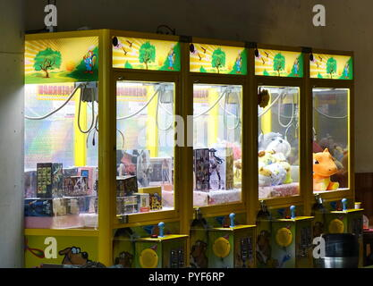 KAOHSIUNG, TAIWAN -- OCTOBER 19, 2018: Claw crane game machines have become the latest fad in Taiwan, occupying many empty store fronts. - Stock Photo