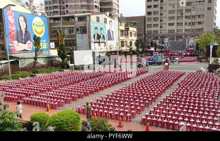 KAOHSIUNG, TAIWAN -- OCTOBER 19, 2018: Stools, water and fans are prepared for a rally for city council candidate Huang Xiangshu of the KMT in the run - Stock Photo