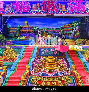 KAOHSIUNG, TAIWAN -- OCTOBER 19, 2018: The Citian Temple puts on an outdoor puppet show that acts out religious themes and stories. - Stock Photo