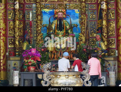 KAOHSIUNG, TAIWAN -- OCTOBER 19, 2018: People bring offerings and pray at the altar of the Yimin Temple. - Stock Photo