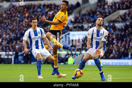 Wolverhampton Wanderers' Raul Jimenez (centre) shoots at goal as Brighton & Hove Albion's Shane Duffy (right) and Lewis Dunk look on during the Premier League match at The AMEX Stadium, Brighton. - Stock Photo