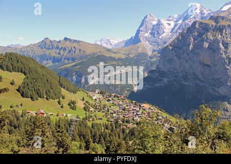 Breathtaking, traffic-free village of Murren in the Bernese Oberland, Switzerland with the Eiger, Monch and Jungfrau mountains in the background - Stock Photo