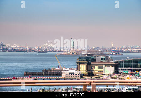 View over the Hudson river and the port of New York City with the Statue of Liberty in the background - Stock Photo