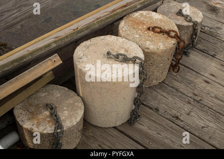 Cement Boat Buoys on dock at Harris Island, York Harbor, Maine (Released). Busy fishing marina with local summer/year round homes in Southern, Maine. - Stock Photo