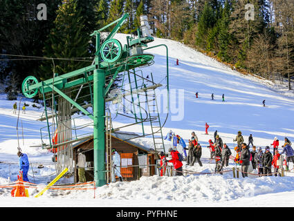 GERARDMER, FRANCE - FEB 19 - Group of skiers standing in line in front of ski lift during the annual winter school holiday on Feb 19, 2015 in Gerardme - Stock Photo