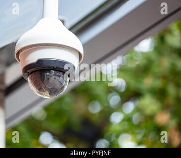 Security concept. Surveillance CCTV Camera on the roof, closeup view - Stock Photo