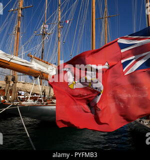 AJAXNETPHOTO. CANNES, FRANCE. - THREE LEGS OF MAN - RED ENSIGN FLAG OF THE ISLE OF MAN FLYING FROM STERN OF A YACHT MOORED IN THE OLD PORT. PHOTO:JONATHAN EASTLAND/AJAX REF:GX8_182509_618 - Stock Photo