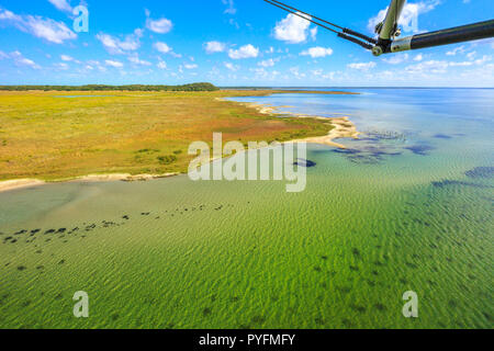 Aerial view of Lake Sibhayi or Sibaya near Sodwana Bay National Park within the iSimangaliso Wetland Park, Maputaland, an area of KwaZulu-Natal on east coast of South Africa. - Stock Photo