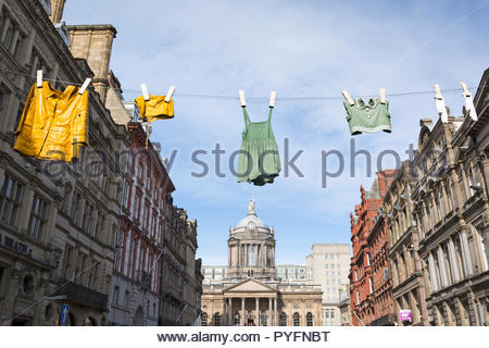 Little Girl Giant's clothes hanging on a washing line across Castle Street, Giant Spectacular, Liverpool's Dream by Royal de Luxe, Liverpool, UK, 2018 - Stock Photo