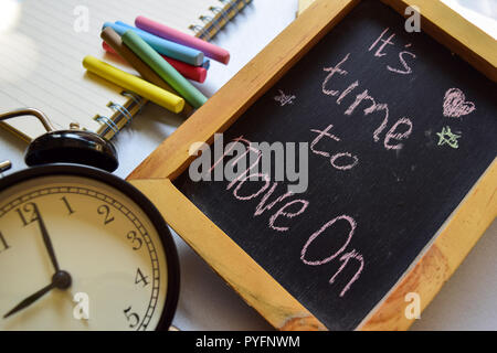 It's time to move on phrase colorful handwritten on chalkboard, alarm clock with motivation and education concepts. - Stock Photo