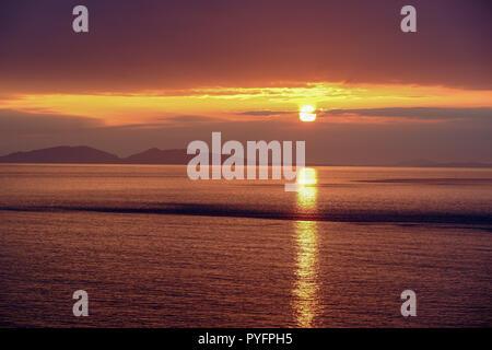 Sunset near Neist Point Lighthouse on Isle of Skye - Stock Photo