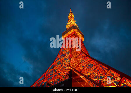 night view of Tokyo Tower illuminated at night. The Tokyo Tower is a telecommunications building and also a panoramic observatory located in Minato district, Tokyo, Japan. - Stock Photo