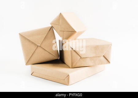 Stack of craft wrapped boxes for delivery on white background - Stock Photo