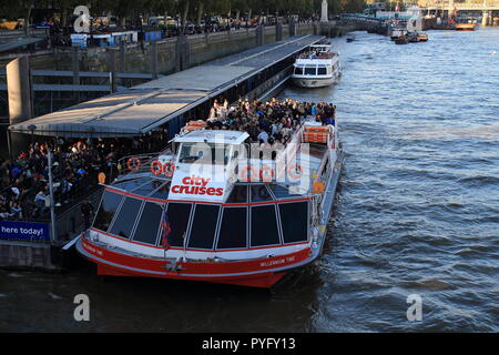 London, UK -20, October 2018: The tour boat of City Cruises at the Westminster pier on River Thames in London - Stock Photo
