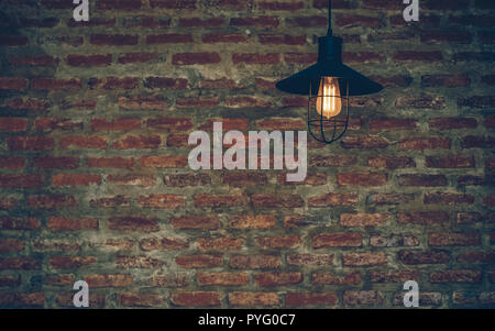 Luxury lighting decoration over the brick wall background - Stock Photo
