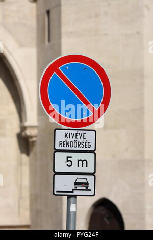 Road signs indicating restricted parking (except for police), parking restricted to five minutes, parking allowed on the pavement, Budapest, Hungary - Stock Photo