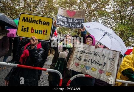 Munich, Bavaria, Germany. 27th Oct, 2018. Counter-demonstrators against Pegida. Attempting to draw more followers and expand PEGIDA into Bavaria, 'Pegida Dresden'' announced an appearance by founders LUTZ BACHMANN and SIEGFRIED DAEBRITZ in Munich's Neuhausen district. Ultimately, the two did not arrive, leaving approximately 40 Pegida followers to march against over 450 counter-demonstrators. Pegida Dresden in Munich is actually Pegida Nuremburg who is attempting to expand south to Munich where the rival Pegida Muenchen is already active. The latter group is more closely associated