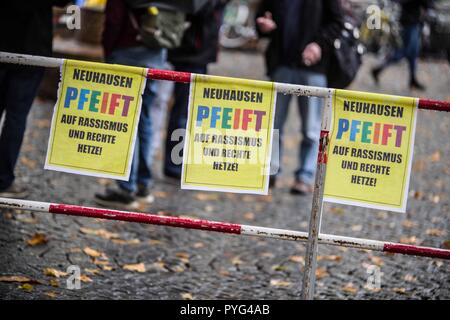 Munich, Bavaria, Germany. 27th Oct, 2018. Attempting to draw more followers and expand PEGIDA into Bavaria, 'Pegida Dresden'' announced an appearance by founders LUTZ BACHMANN and SIEGFRIED DAEBRITZ in Munich's Neuhausen district. Ultimately, the two did not arrive, leaving approximately 40 Pegida followers to march against over 450 counter-demonstrators. Pegida Dresden in Munich is actually Pegida Nuremburg who is attempting to expand south to Munich where the rival Pegida Muenchen is already active. The latter group is more closely associated with neo-nazis, convicted terrorists,