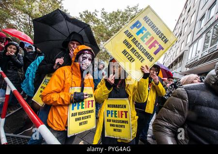 Munich, Bavaria, Germany. 27th Oct, 2018. Counter-demonstrators against Pegida using the ''Neuhausen Pfeift'' action signs. Attempting to draw more followers and expand PEGIDA into Bavaria, 'Pegida Dresden'' announced an appearance by founders LUTZ BACHMANN and SIEGFRIED DAEBRITZ in Munich's Neuhausen district. Ultimately, the two did not arrive, leaving approximately 40 Pegida followers to march against over 450 counter-demonstrators. Pegida Dresden in Munich is actually Pegida Nuremburg who is attempting to expand south to Munich where the rival Pegida Muenchen is already active.