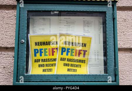 Munich, Bavaria, Germany. 27th Oct, 2018. A restaurant displays ''Neuhausen Pfeift'' signs in their display case as part of a business action against Pegida. Attempting to draw more followers and expand PEGIDA into Bavaria, 'Pegida Dresden'' announced an appearance by founders LUTZ BACHMANN and SIEGFRIED DAEBRITZ in Munich's Neuhausen district. Ultimately, the two did not arrive, leaving approximately 40 Pegida followers to march against over 450 counter-demonstrators. Pegida Dresden in Munich is actually Pegida Nuremburg who is attempting to expand south to Munich where the rival P