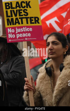 London, UK, 27th October, 2018. Friends, family and supporters campaigning for justice for people who died in custody, or while being arrested  take part In the 20th annual march organised by the United Families and Friends Campaign. The march  goes from Trafalger Square to Downing Street, where a petition is handed in. Roland Ravenhill/Alamy Live News. - Stock Photo