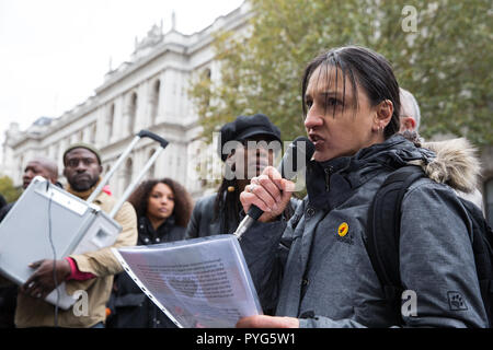 London, UK. 27th October, 2018. Becky Shah of the Hillsborough Justice Campaign, daughter of Inger Shah, addresses campaigners from the United Families and Friends Campaign (UFFC) taking part in the 20th annual procession to Downing Street in remembrance of family members and friends who died in police custody, prison, immigration detention or secure psychiatric hospitals. Inger Shah died in the Hillsborough disaster on 15th April 1989. Credit: Mark Kerrison/Alamy Live News - Stock Photo