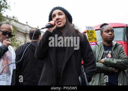 London, UK. 27th October, 2018. Lisa Cole, sister of Marc Cole, addresses campaigners from the United Families and Friends Campaign (UFFC) taking part in the 20th annual procession to Downing Street in remembrance of family members and friends who died in police custody, prison, immigration detention or secure psychiatric hospitals. Marc Cole, 30, died after being tasered by police called to reports of a man 'slashing himself' with a knife in Falmouth in May 2017. Credit: Mark Kerrison/Alamy Live News - Stock Photo